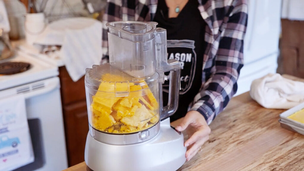 Freeze dried eggs getting pulsed in the food processor.