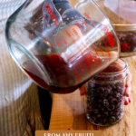 Pinterest Pin for how to make fruit vinegar with an image of fruit vinegar being made.