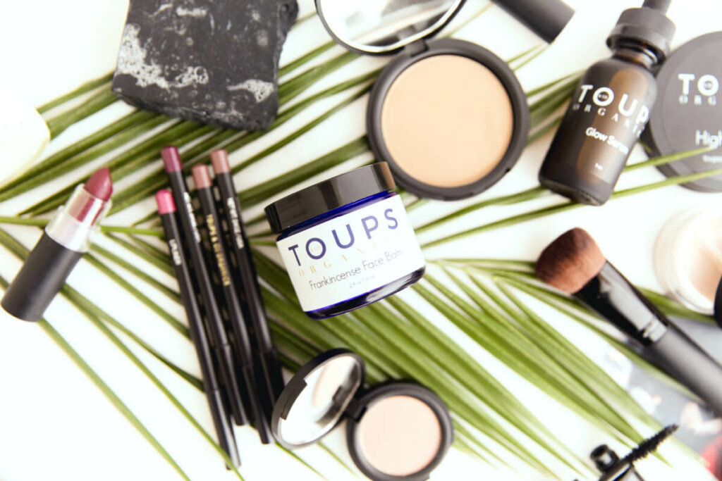 Toups & Co. skincare products laid out on a counter.