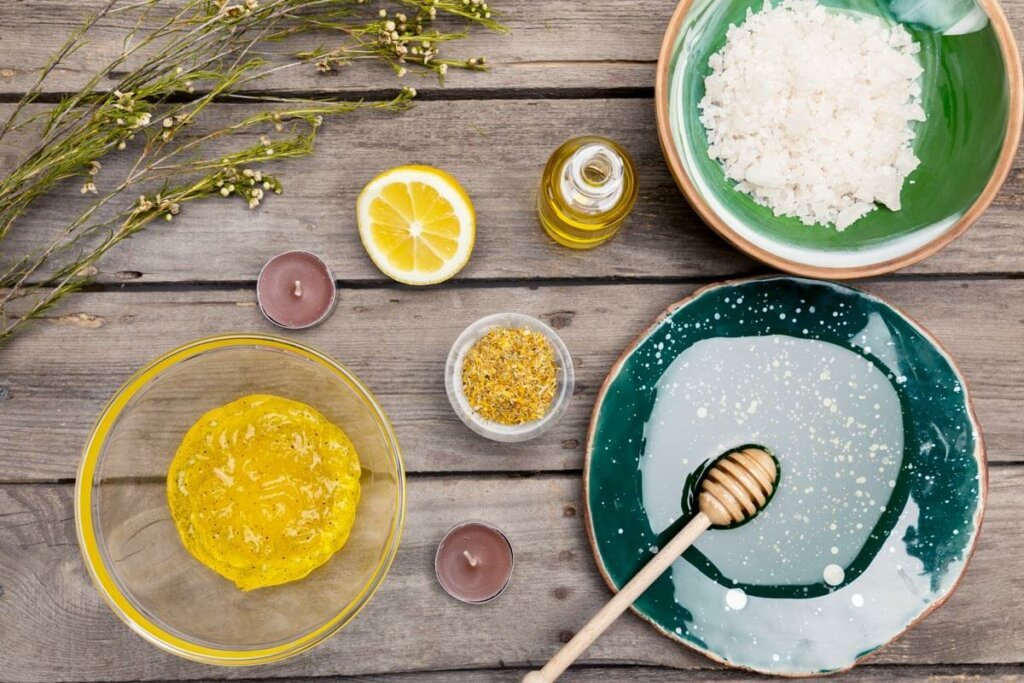 Natural skincare ingredients on a table. Honey, lemon, etc.