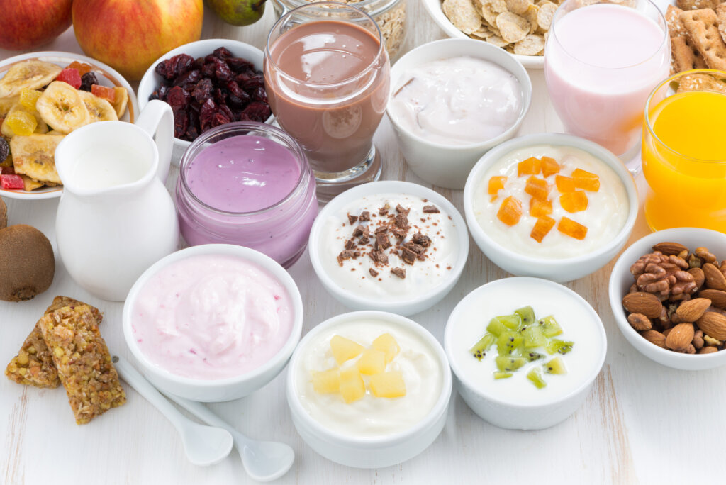 Bowls of yogurt topped with different toppings.