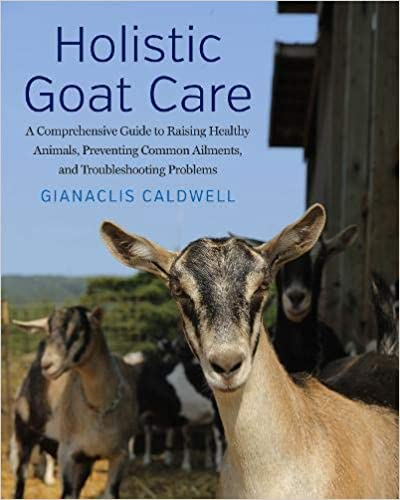 Book cover for Holistic Goat Care. Image of goats next to a large barn.