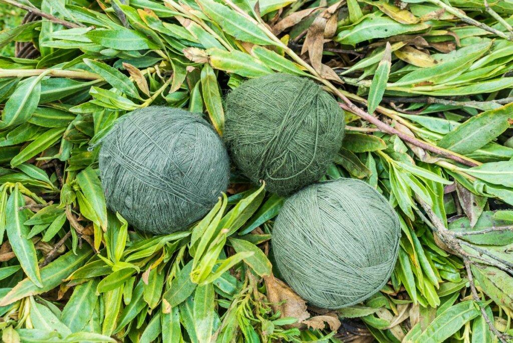 Naturally dyed green balls of yarn.