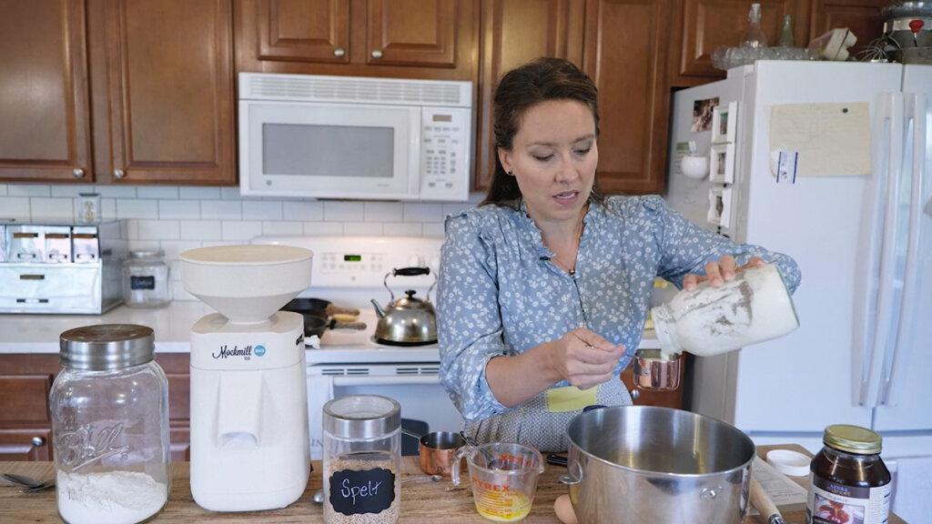 Woman measuring buttermilk.